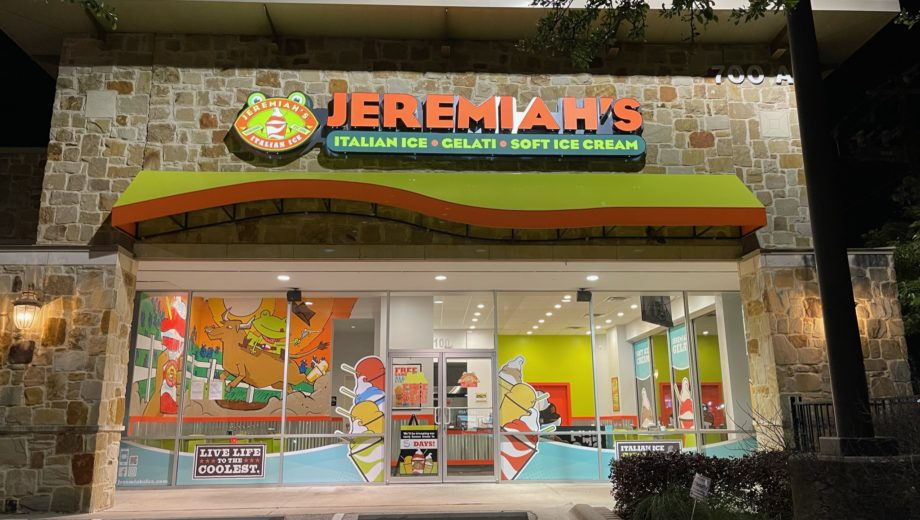 Exterior night shot of a Jeremiah's Italian Ice franchise in Texas.